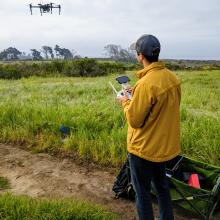 Masters student Ryan Allen flies a UAS at Coal Oil Point UC Reserve, for 802.15.4 eqpirements. 2019