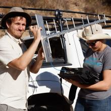 Michael Nekrasov and Esther Showalter set up TV antenna for TVWS signal strength sensing. 2018.