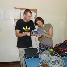 Paul and Mariya setting up a wireless bridge in Macha.  Dec 2013