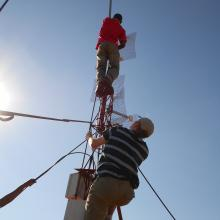 David climbing a tower to install a VillageCell antenna. 2012