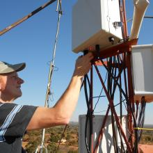 David installing a VillageCell base station in Macha. 2012